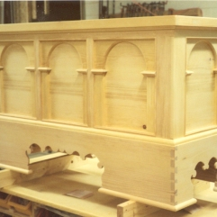 The elaborately fret-sawed base profile is typical of many continental chests.