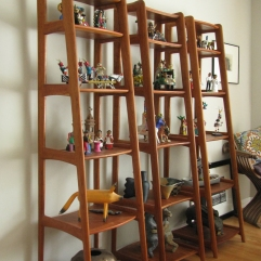 Custom designed and built from teak, this set of three Danish Modern shelves were made to hold a unique collection.