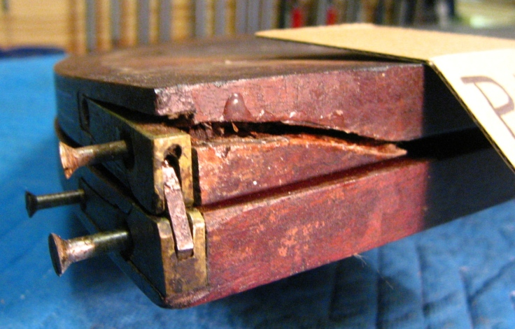 Photo of knife hinge and mortise damage old repairs