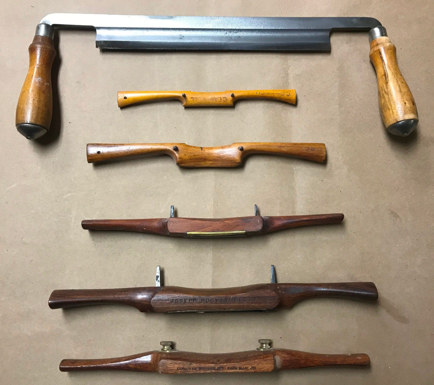 A drawknife and selection spokeshaves