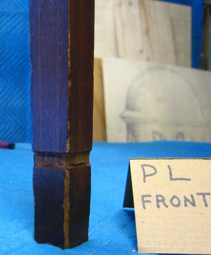 Photo of missing inlay at bottom of front table leg