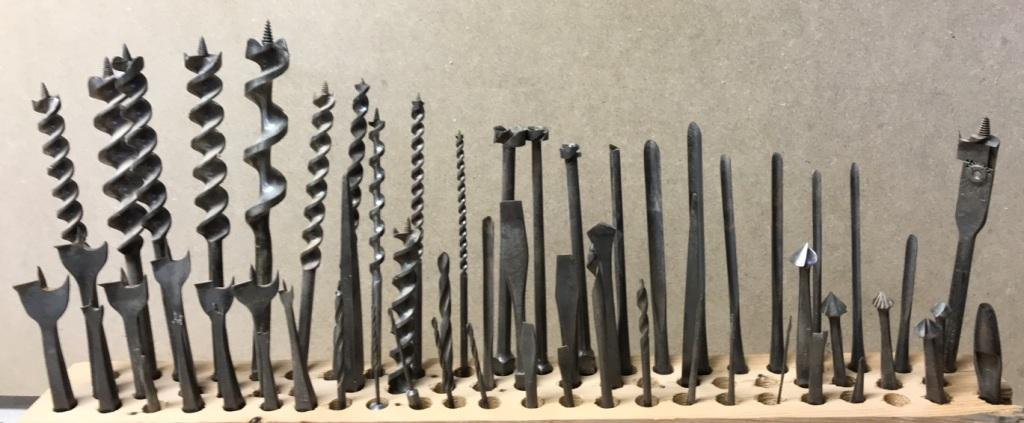 A collection of old wood drill bits augers forstners shell nose center expansion twist drill that all were made to fit the hand brace