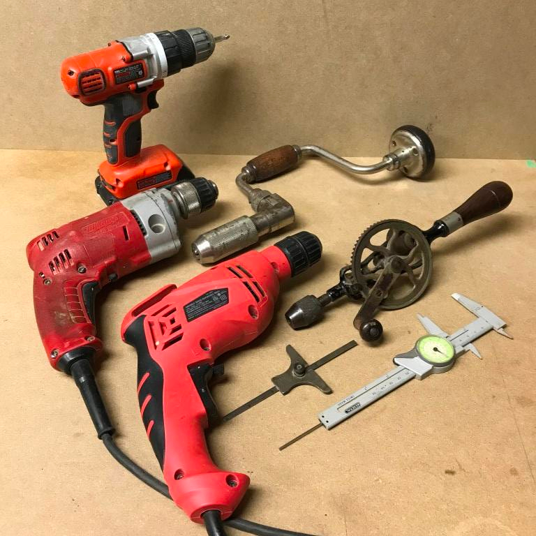A selection of drills both electric and hand powered