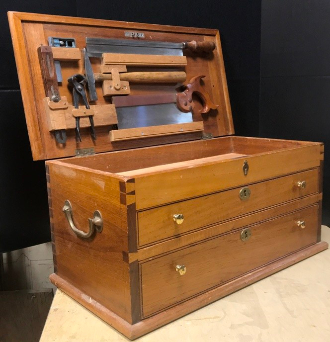 mahogany tool chest with lid open and tools displayed