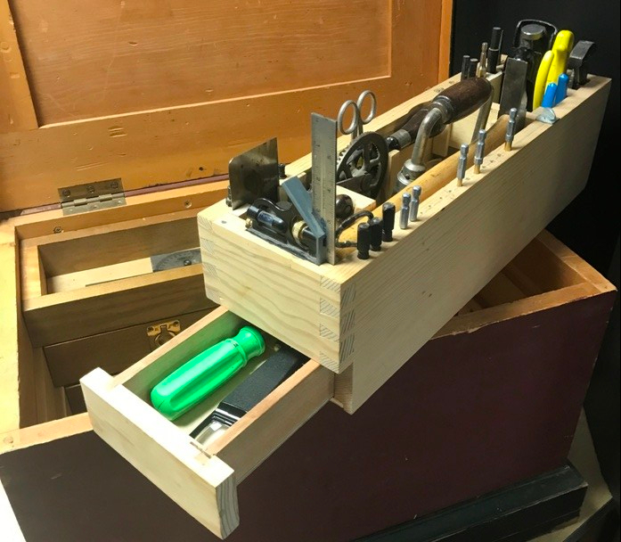 Tool Tote sitting on top of chest with integral bottom drawer open