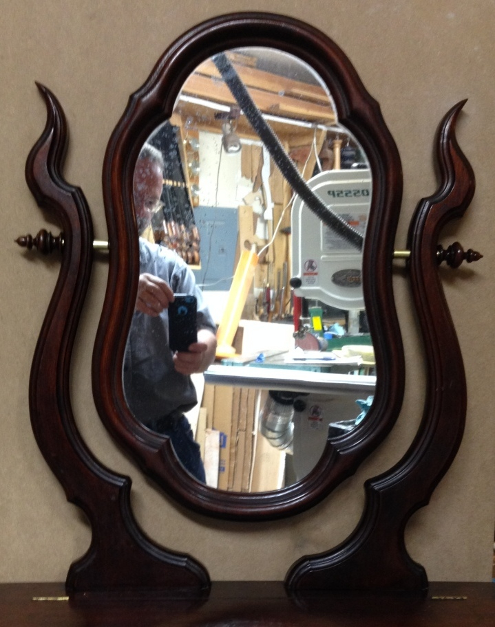 A circa 1875 dressing mirror made for table top use